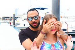 Lover Surprise him Girl. On the marina of yachts Royalty Free Stock Photos