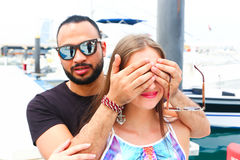 Lover Surprise him Girl. On the marina of yachts Royalty Free Stock Images