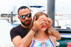 Lover Surprise him Girl. On the marina of yachts Royalty Free Stock Photo