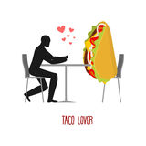 Lover taco. Lovers in cafe. Man and fastfood sitting at table. M Royalty Free Stock Photos