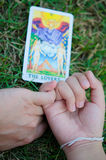 Lover Tarot make Real Love. A couple holding their fingers in front of the Lover tarot card Stock Photography