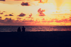 Lover watching sunset at the sea. Vintage style Royalty Free Stock Photography