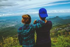 Lover woman and man asians travel relax in the holiday. Watch the beauty wild nature wood on the mountain. Lover women and men asians travel relax in the holiday royalty free stock images