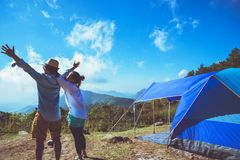Lover women and men asians travel relax camping in the holiday. On the Moutain.Thailand. Lover women and men asians travel relax camping in the holiday. On the stock photos