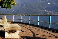 Lovere town - resting place on the shores of Lake Iseo in autumn. Pisogne comune is in the back right. Lago d`Iseo or Sebino is the fourth largest lake in royalty free stock photos