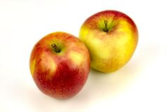 Loverly apples and oranges. View of fully ripe apples and oranges on a plain background royalty free stock photos
