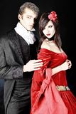 Lovers. Portrait of a beautiful couple in medieval costumes with vampire style make-up. Shot in a studio Stock Photos
