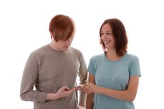 Lovers. A young man gives his girlfriend money royalty free stock photography