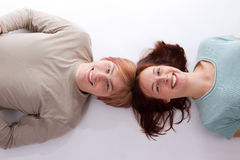 Lovers. A young couple lying on the floor Stock Photography