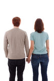 Lovers. A young couple stands hand in hand stock image