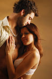 Lovers. A woman embraces his boyfriend Stock Photography