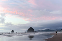 Lovers admiring Haystack rock at sunset Royalty Free Stock Image