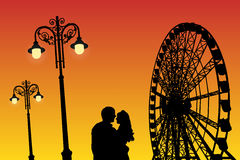 Lovers in amusement park at sunset. Vector illustration with silhouette of loving couple under starry sky. Vintage lampposts and Ferris wheel. Bright gradient stock illustration