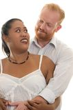Lovers in arms. Diversity lovers embrace and look into each other's eyes Stock Photo