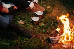 Lovers around the campfire at night Royalty Free Stock Image