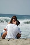 Lovers on the beach royalty free stock photography