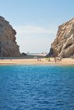 Lovers Beach at Cabo San Lucas. This is Lovers Beach (Playa de Amor) on the bay of Cabo San Lucas, Mexico, next to Los Arcos.  This strip of sand connects the Royalty Free Stock Images