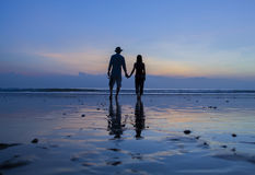 Lovers on the beach. Sunset at Ngwesaung beach, fall Stock Photography