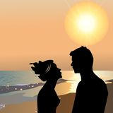 Lovers on the beach at sunset Stock Photography