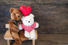 Lovers bear and red chocolate heart. Stock Photography