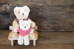 Lovers bear and red chocolate heart. Royalty Free Stock Images