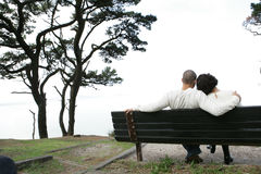 Lovers on bench Stock Image
