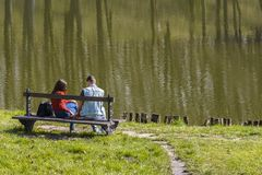 Lovers on a bench stock photography