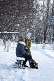 Lovers on a bench in winter Stock Photo