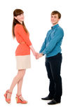 Lovers of boy and girl holding hands in full view Royalty Free Stock Images