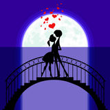 Lovers at bridge in moonlight Royalty Free Stock Image
