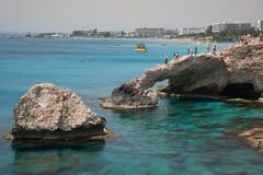 Lovers Bridge, Sea caves Ayia Napa Cyprus. Agia Napa, , Cyprus, April  29, 2019: People standing above Sea caves on the famous lovers bridge, near Ayia Nape royalty free stock images