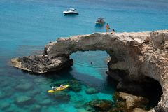 Lovers Bridge, Sea caves Ayia Napa Cyprus. Agia Napa, , Cyprus, April  29, 2019: People standing above Sea caves on the famous lovers bridge, near Ayia Nape stock photos