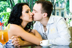 Lovers in the cafe. Lovers are kissing in the cafe Royalty Free Stock Photos