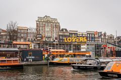 Lovers Canal Cruises pickup location with many boats in the foreground in Amsterdam. royalty free stock photo