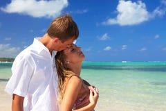 Lovers on caribbean beach Stock Photos