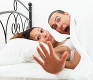 Lovers caught in bed Stock Photography