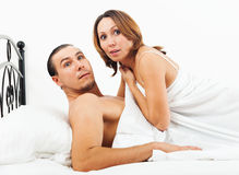 Lovers caught in bed Royalty Free Stock Images