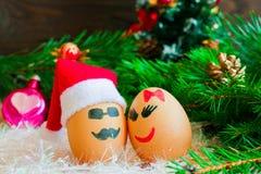 Lovers on  Christmas, cartoon . Unusual eggs with faces, muzzle. Lovers on Christmas, cartoon . Unusual eggs with faces, muzzle Stock Photo