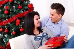 Lovers at Christmas eve Stock Photo