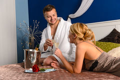 Lovers clinking champagne glasses bed enjoy anniversary Royalty Free Stock Photos