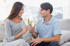 Lovers clinking their flutes of champagne Royalty Free Stock Photo