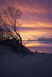 Lovers at coast sunset. Lovers at coast warm colorfull autumn sunset Royalty Free Stock Photo
