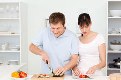 Lovers cooking together in the kitchen Royalty Free Stock Photography
