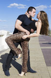 A lovers couple dancing outdoors in pose Royalty Free Stock Images