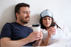 Lovers couple drinking coffee in the morning Stock Image