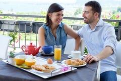 Lovers couple having breakfast Stock Photos