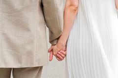 Lovers couple holding hands Stock Photography
