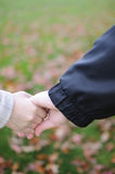 Lovers couple holding hands Stock Photo