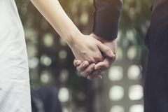 Lovers couple holding hands, love and romance concept Royalty Free Stock Images