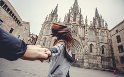 Lovers couple holding hands in a Cathedral Holy Cross and Saint Eulalia Stock Photo